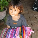 Little girl, at the foot of the waterfalls, Siem Reap