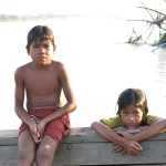 Kids swimming in the backwaters of Cambodia